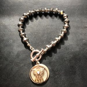"Bracelet with ""Linda"" engraved and angel"